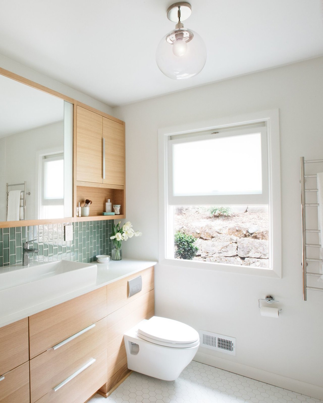 Bath Room, One Piece Toilet, Ceramic Tile Floor, Ceiling Lighting, and Vessel Sink  Photo 3 of 15 in What's the Best Way to Save Space in a Small Bathroom?