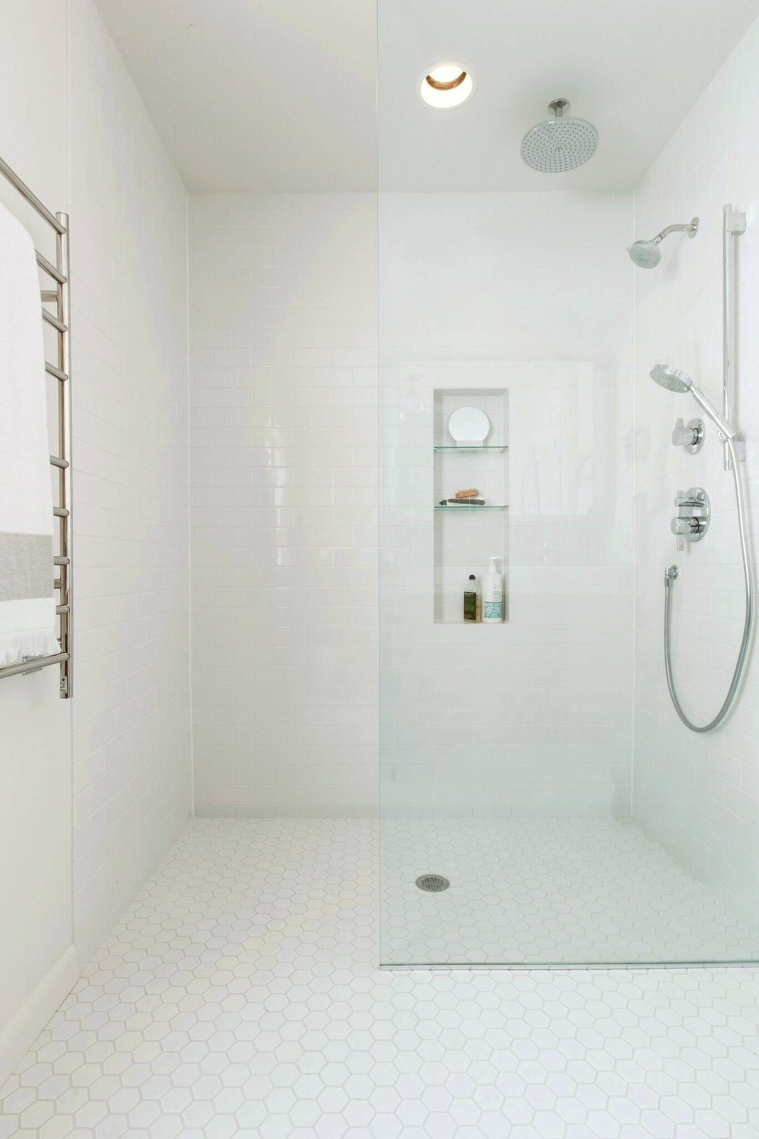 Bath Room, Ceramic Tile Floor, Subway Tile Wall, and Enclosed Shower  Photo 5 of 15 in What's the Best Way to Save Space in a Small Bathroom?