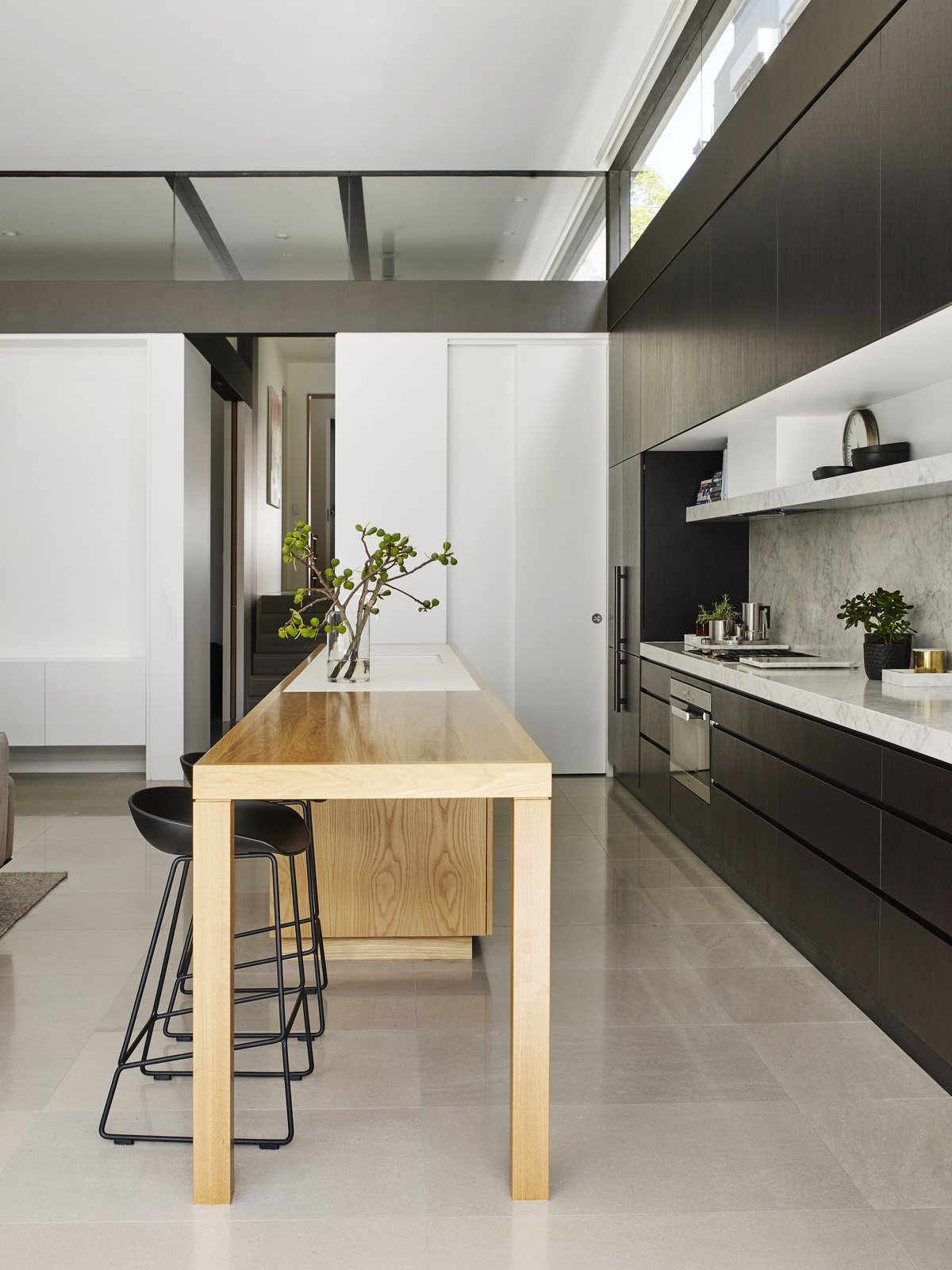 Kitchen, Wall Oven, Refrigerator, Open Cabinet, Undermount Sink, Wood Counter, Range, and Marble Counter  Photos from A Sleek, Two-Story Addition Hides Behind a Traditional Cottage in Sydney