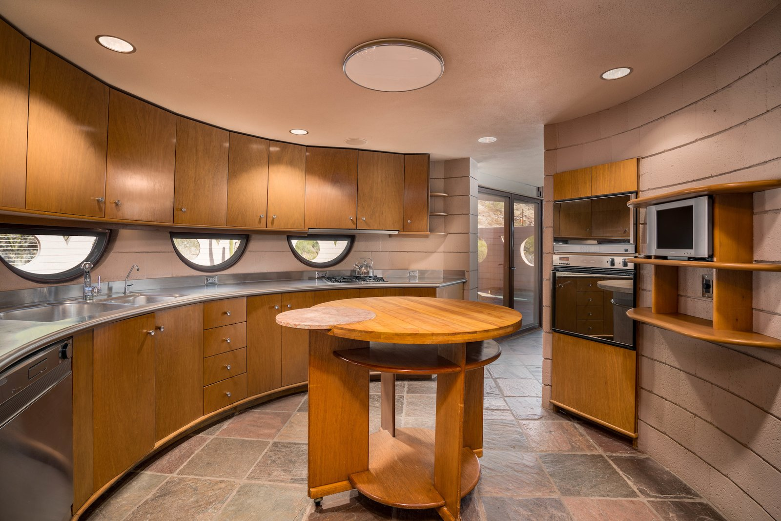 Kitchen, Dishwasher, Drop In, Cooktops, Recessed, Range, Metal, Microwave, Wood, Range Hood, and Ceiling  Best Kitchen Microwave Drop In Range Hood Recessed Photos from The Last House Designed by Frank Lloyd Wright Hits the Market at $2.98M
