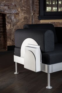 The furniture also comes with a sleek, scalloped magazine rack.