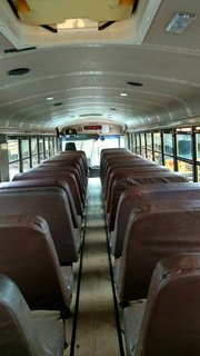 "When the Mayes Team found ""Skoolie,"" it still had the bus seats intact."