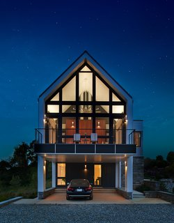 The client can enjoy the outdoors day or night via the screened porch and deck.