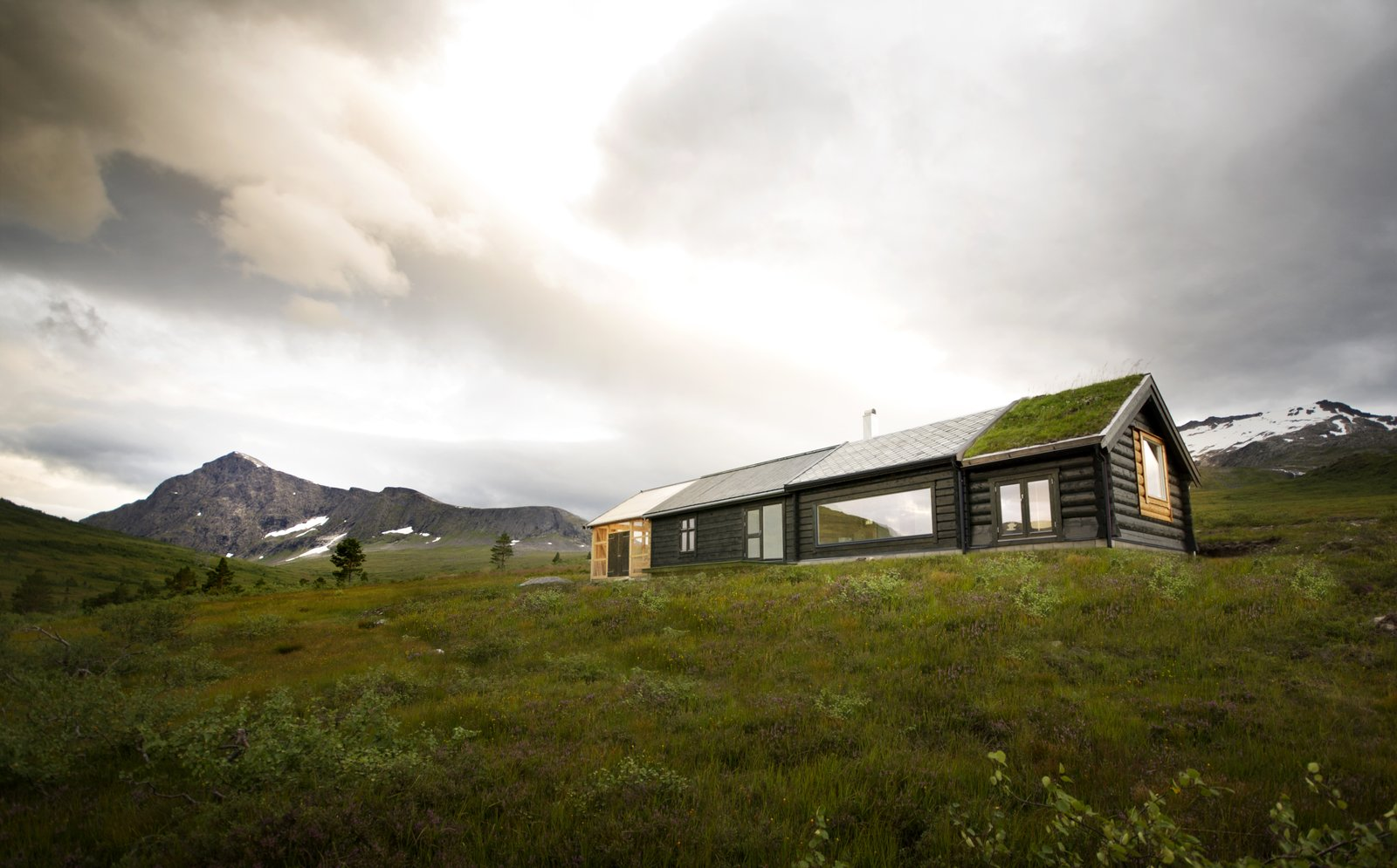 Exterior, Gable RoofLine, Cabin Building Type, Green Roof Material, Wood Siding Material, House Building Type, and Tile Roof Material Another view of the back of the building.  Photo 8 of 8 in This Astounding Cabin in Norway Is a Patchwork of Different Materials