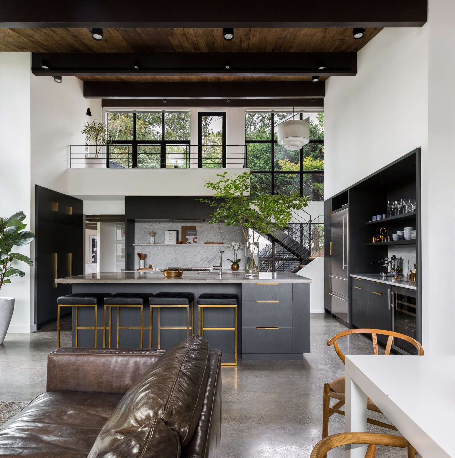 Montlake House kitchen with black steel stairway and concrete floors