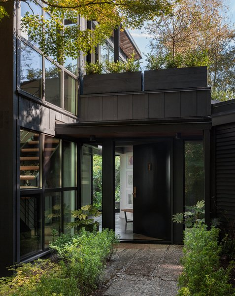 The exterior's updated siding and new windows help to create a cohesive look.