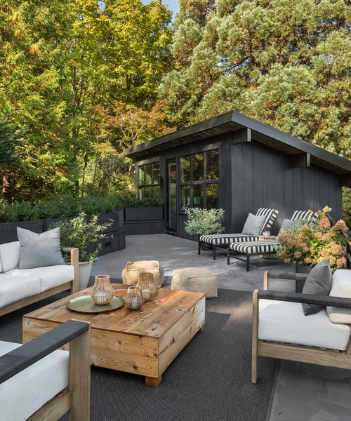 The roof terrace offers an outdoor lounge space, as well as views into the lush Seattle hills.