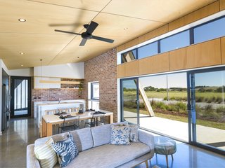 The home's rectilinear floor plan facilitates coastal cross-breezes (or passive cooling), while thermally broken double-glazed windows ensure the building envelope stays tight to reduce carbon emissions.
