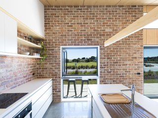 A pass-through window in the kitchen connects to the porch for ease of socializing.