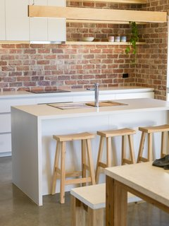 The kitchen stools are from Tuscan Outdoor Tables, a Dandenong, Victoria, outfit that crafts furniture from local Cypress and reclaimed timber.