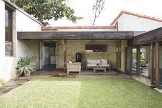 A view of the lanai with the kitchen behind it.