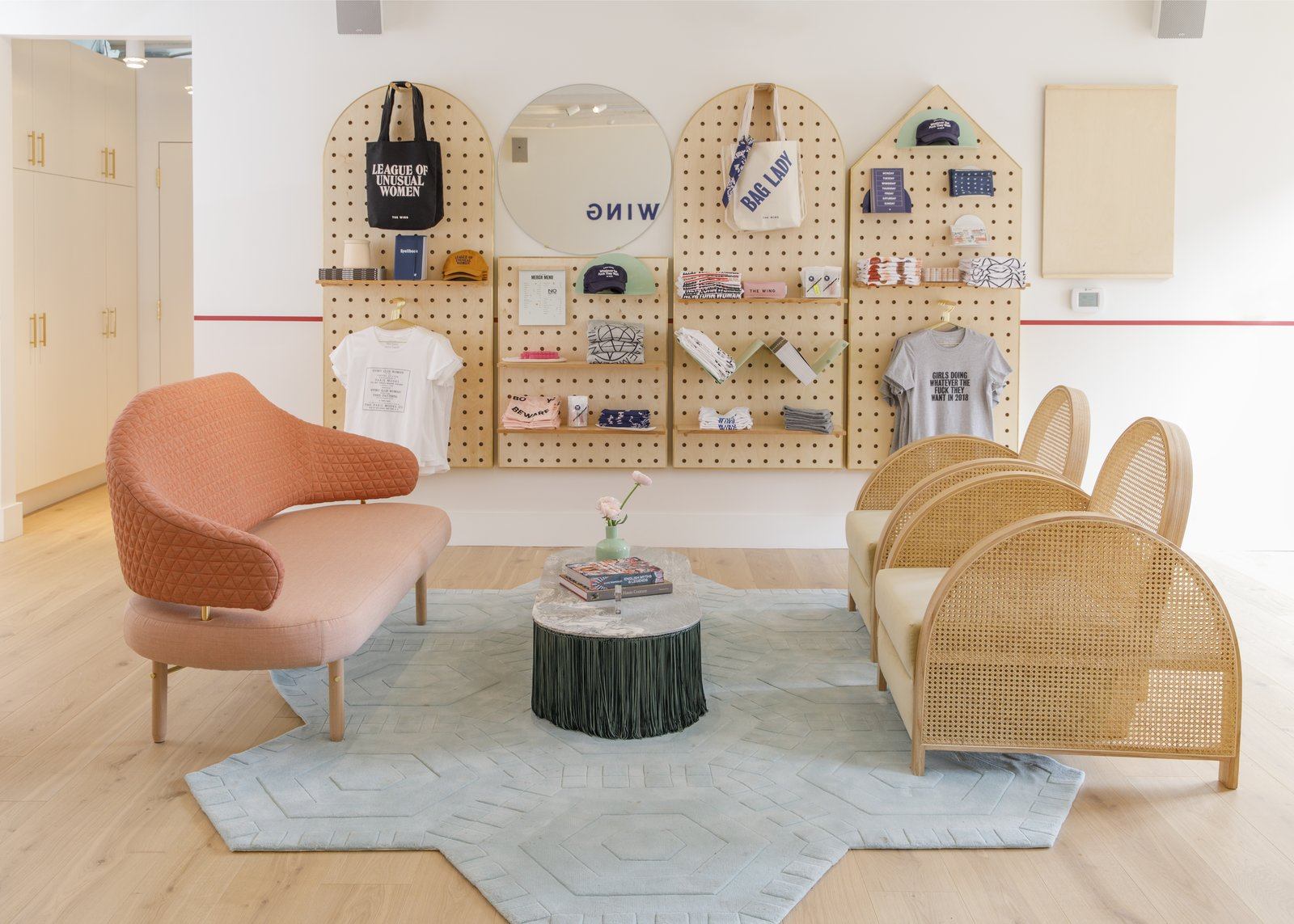 In the reception area, the Arch Chair from father-and-daughter New Zealand makers Douglas and Bec sits atop the Sky Swizzle Honeycomb area rug from Kinder Modern. Although there are multiple clusters of seating to encourage collaboration, members are also offered numerous private nooks for solitary work.