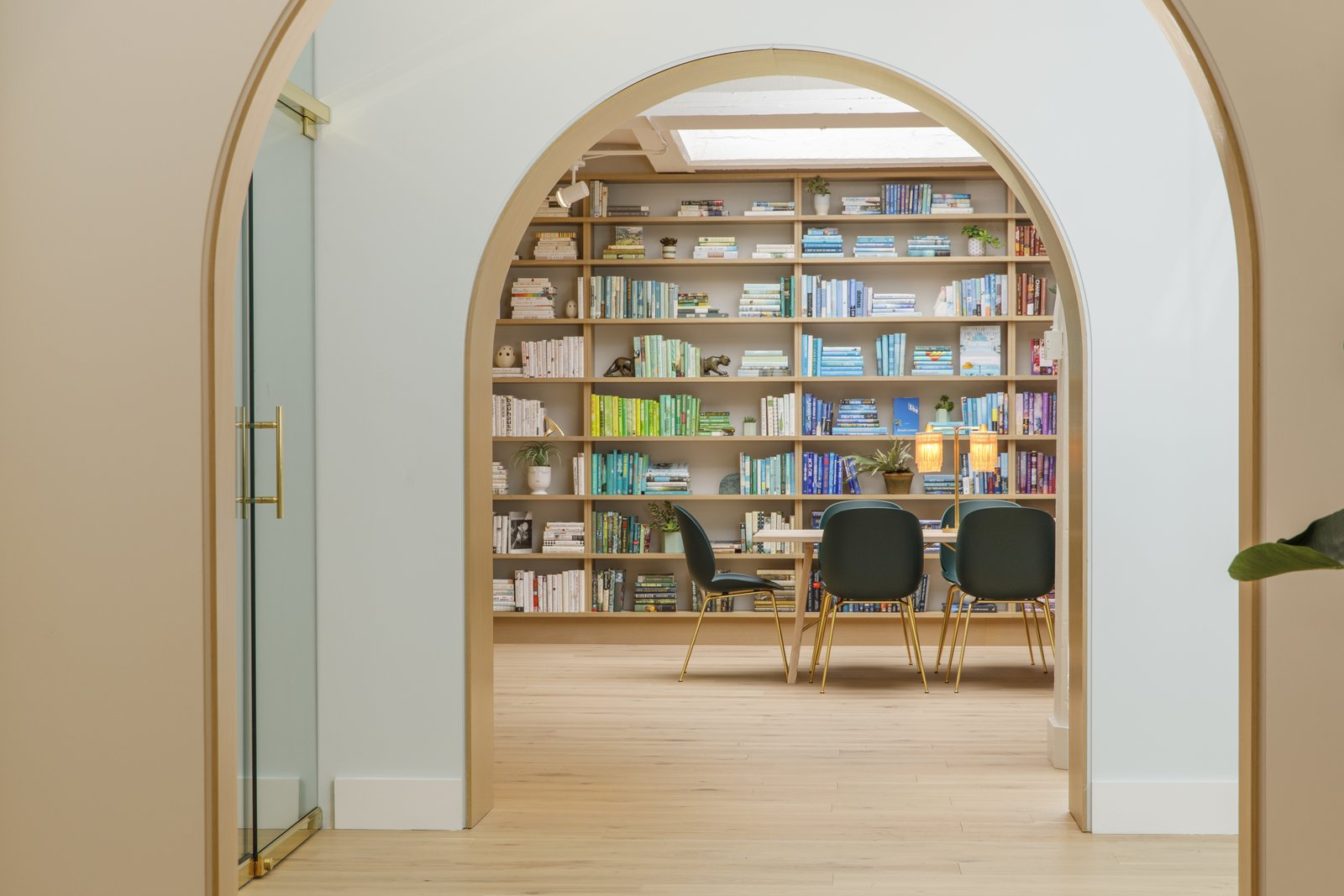 Office, Library Room Type, Chair, Desk, Lamps, Shelves, Study Room Type, Light Hardwood Floor, and Storage  Photo 1 of 13 in Feast Your Eyes on Washington D.C.'s Newest Co-Working Space For Women