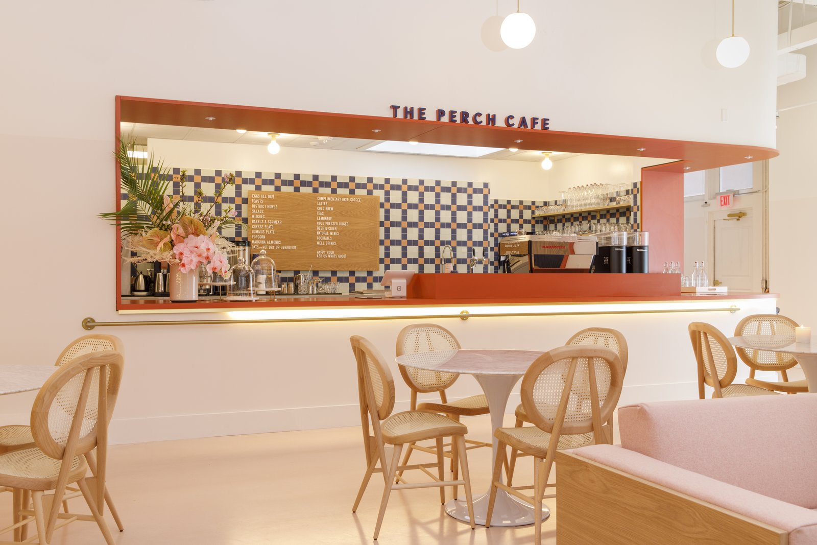 At the Perch Cafe, the Clé Tile backsplash is a striking focal point behind the tulip tables and chairs from Cru. The cafe menu incorporates offerings from local women-owned companies.