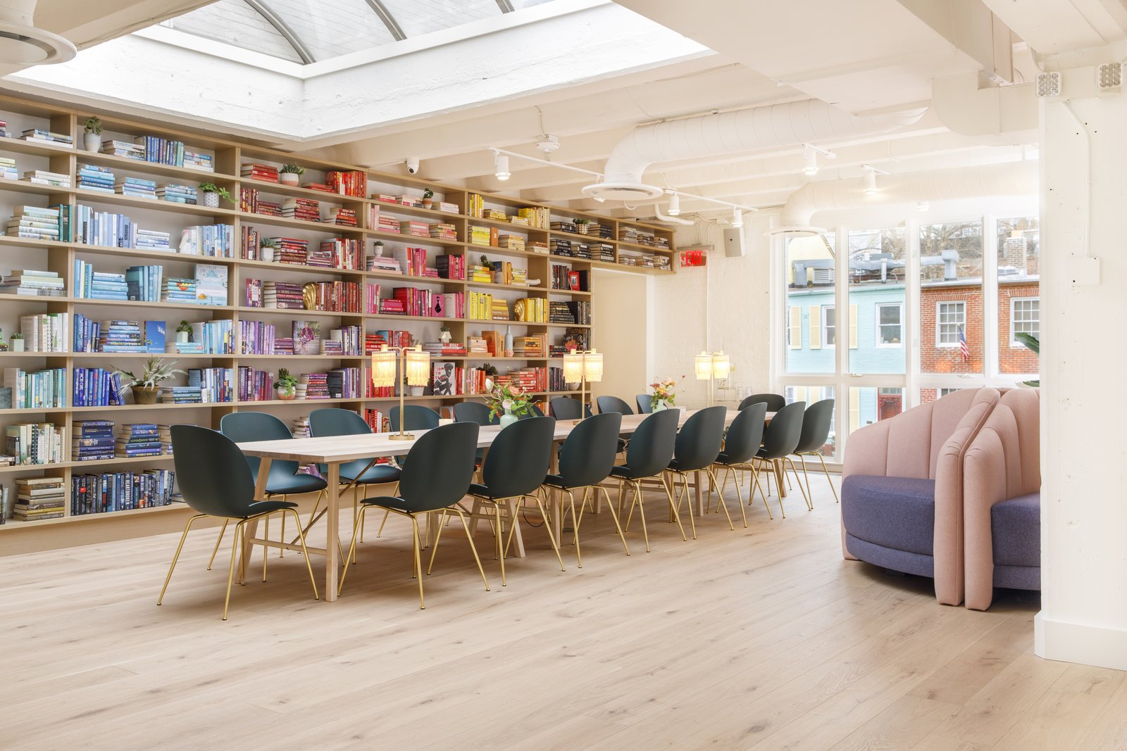 "A communal table sits in the lending library, which features over 2,000 female-written titles, all curated by the Strand Bookstore. A ""Wing Women Reading List of 50 must-read titles,"" composed by The Lantern—a local non-profit bookstore run by Bryn Mawr grads—is also available for use."