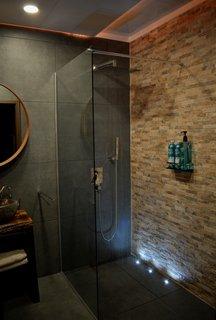 The Lodge includes a spa bathroom with a rain shower head.