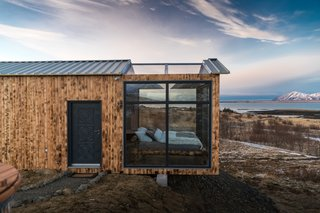 The cabin is located in Hvalfjörður, Iceland, just a 30-minute drive from Reykjavík, and can only be accessed by car. The area is remote, private, and quiet, making it ideal for viewing the Northern Lights at night, as well as hiking during the day.