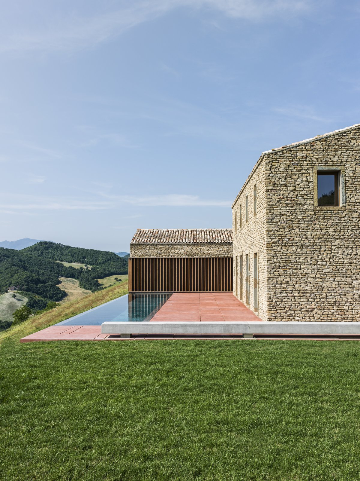 Exterior, Stone Siding Material, Gable RoofLine, House Building Type, and Tile Roof Material  Photos from A Minimalist Residence Rises From Medieval Italian Ruins