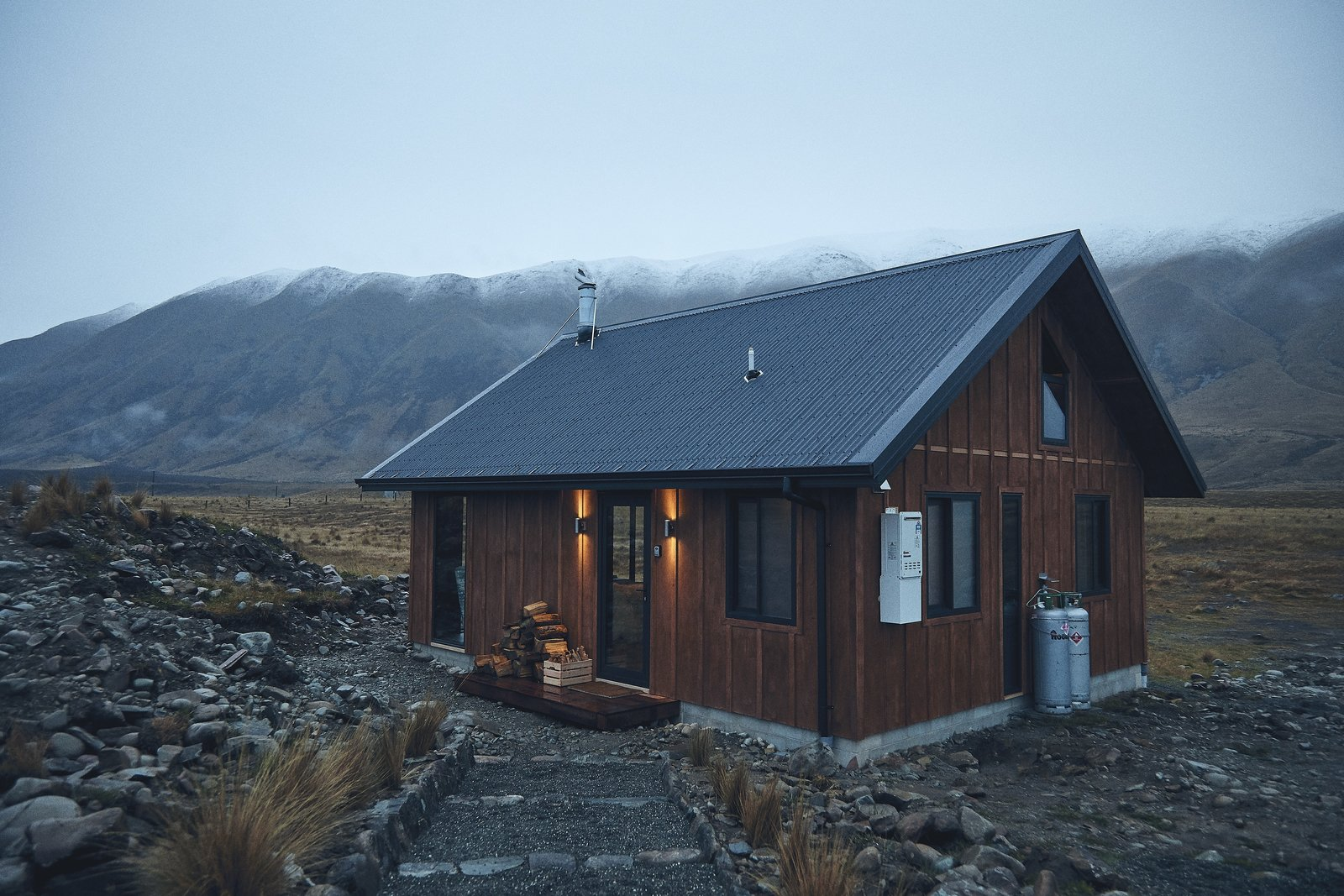 Exterior, Cabin Building Type, Metal Roof Material, Gable RoofLine, and Wood Siding Material The exterior siding is in a traditional board and batten style, then accented with a steel roof and windows.  Photo 9 of 9 in You Won't Want to Leave This Cozy Cabin in New Zealand