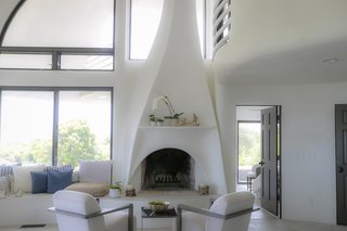 The lines of the fireplace column echo the exterior geometry.