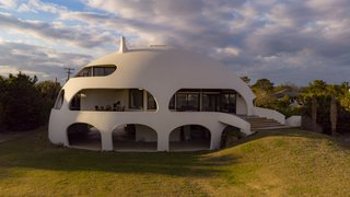"The ""Eye of the Storm"" sits on a .48-acre lot fronting the beach, only 230 feet from the water."