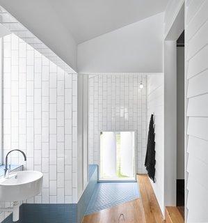 The angled tile floor-pad designates the entrance to the bathtub area.
