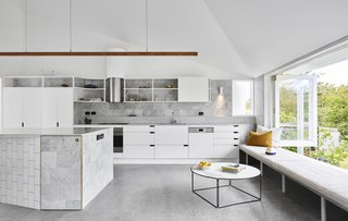 Now, the new kitchen is ideal for cooking big meals and socializing. White cabinetry and Carrara marble counters lend an airy feel.