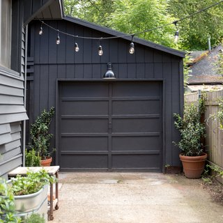 "Carstensen painted the body and exterior trim on the garage the same color, in order to ""make the house look slightly more modern, without losing character,"" he said. The color is a discontinued shade, called Evening Canyon, from Behr, that he had mixed at Home Depot.  ""I tried so many before landing on this one,"" he said. ""This one ended up being my favorite, because it maintains a nice warm tone all throughout the day. Others would end up either looking too cool (almost navy blue) in direct sunlight, or just look brown."""