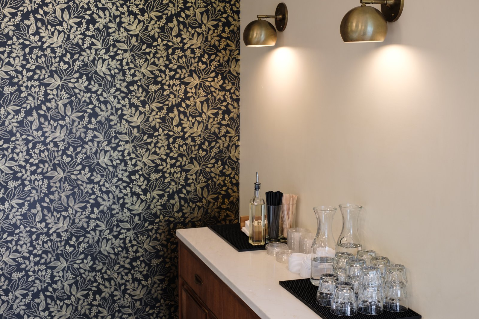 Dining Room, Bar, and Wall Lighting The dark-hued wallpaper from Rifle Paper offsets the brass sconces from Schoolhouse Electric.   Photo 14 of 15 in 10 Best-Designed Places to Eat and Drink in Portland, Oregon