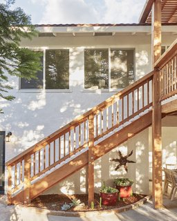The entire redwood structure elevates the previously ordinary backyard, and also improves the overall value of the home.