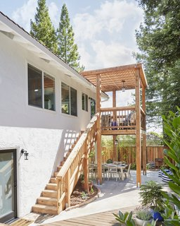 """A view of the new redwood structure, complete with rebuilt stairs. """"It has basically made the house look 100% better from the outside,"""" Soria said."""