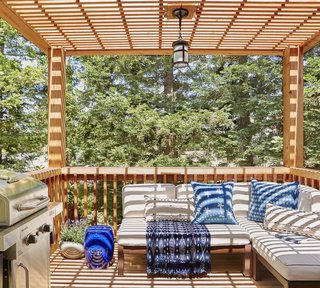 The upper level of the deck now provides a cozy hangout spot right off the kitchen. The roof casts beautiful dappled shade.