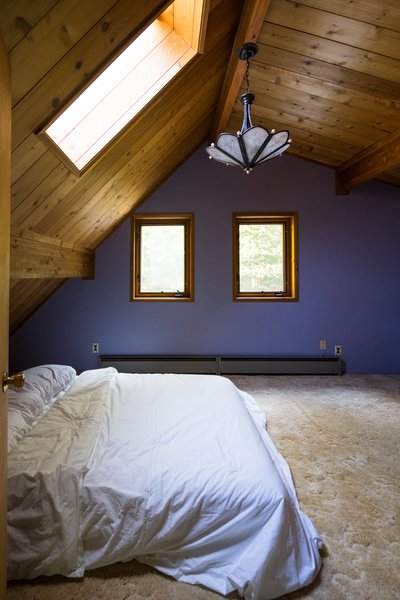 Before: Purple walls, fluffy carpeting, and a boring chandelier would have to go, but the pine paneling stayed.