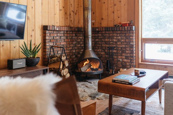 """The focal point of the revamped living room is the new old fireplace, which is a vintage copper Preway. """"It's from a midcentury vintage marketplace in Long Beach, California, called Urban Americana. They have an amazing selection always and we can count on them being in great condition,"""" the couple tell Dwell. """"It's the pinnacle of the home."""""""
