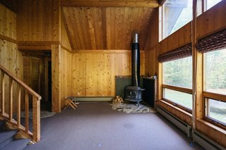 Before: When the couple bought the cabin, its good bones were apparent, and they knew they'd just need to make small tweaks to freshen it up.