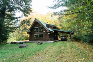 The 1,089-square-foot cabin sits on 1.5 acres of land.