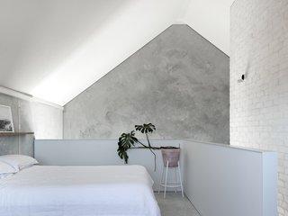 The mezzanine level hosts the bedroom.