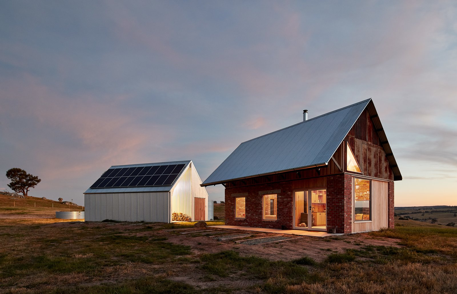 The 500-square-foot cabin and adjacent shed are 100 percent off-grid, with water, sewer, and electrical systems in place to support these buildings and any future development.
