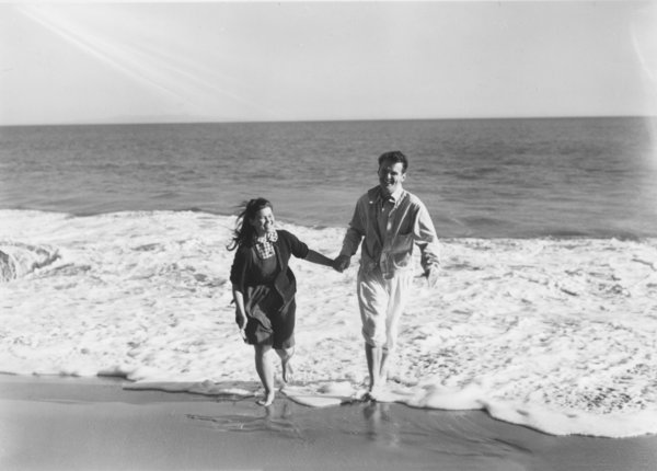 Charles and Ray Eames at the beach in California, early 1940s.
