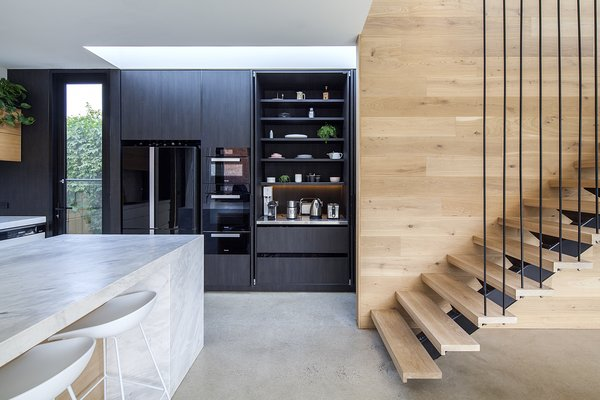 A detailed shot inside the pantry shows how it corrals counter clutter and hides small appliances.