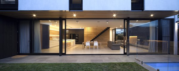 """""""The challenge was to get the best light into the living areas,"""" say the architects. """"So, we employed a full-height wall of glass to the northwest with two large sliding panels of glass, to create a diluted boundary between inside and outside."""""""