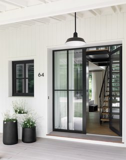An exterior light from Barn Light Electric illuminates the entry.