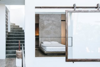 A 215-square-foot room tucked behind a rolling glass window.