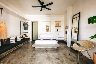 A floating concrete bench and inset wall niches adorn a 240-square-foot room.