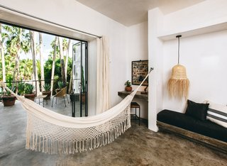 """Some rooms come with hammocks, and there's even a """"Hammock Tower"""" for rooftop lounging."""