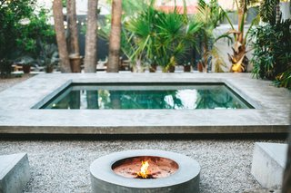 The concrete pool and firepit located in the communal courtyard.