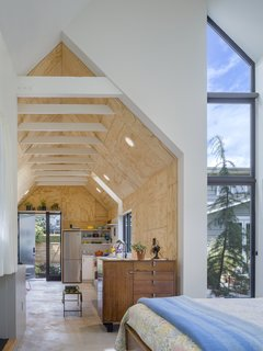 Slim, full-height Milgard windows bring in light, yet allow for privacy between the main house and the Granny Pad.