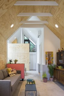 High ceilings with exposed rafters let the Granny Pad live larger than its small footprint, while strategically placed windows and skylights bring in lots of natural light. The couch is from West Elm and the coffee table is a Room and Board find.
