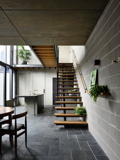 At the rear of the property, the team added a two-story extension, which included this open-concept kitchen and dining area, as well as bathrooms, bedrooms, and a lounge area.