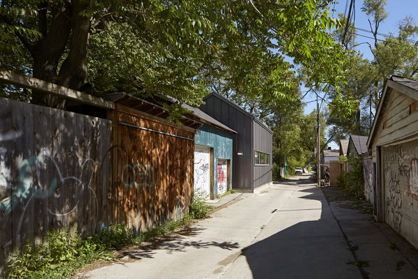 The College Laneway House occupies a small footprint, just 1450-square-feet, where a dilapidated fishing lodge once stood. Its pitched roof blends in with adjacent buildings.